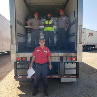 Borden employees prepare to send off the third truck full of beverages for World Central Kitchen. Pictured from left to right are Dothan, Ala. employees Glynn Brown, Leonard Ward and Brian Garrard. Pictured on the ground is Tony Owens.